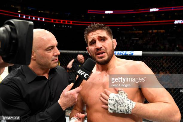Patrick Cote of Canada throws down his gloves after his unanimous decision defeat to Thiago Alves of Brazil signaling his retirement from UFC after...