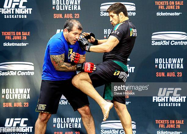 Patrick Cote works out with a trainer at a press conference at the SaskTel Centre June 24 2015 in Saskatoon Saskatchewan Canada