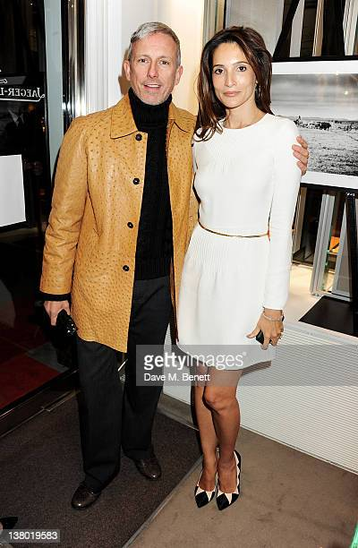 Patrick Cox and Astrid Munoz attend a private viewing of 'Gaucho' a photographic exhibition by Astrid Munoz at the JaegerLeCoultre Boutique on...