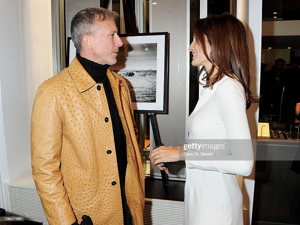 Patrick Cox (L) and Astrid Munoz attend a private viewing of 'Gaucho', a photographic exhibition by Astrid Munoz, at the Jaeger-LeCoultre Boutique on January 31, 2012 in London, England.