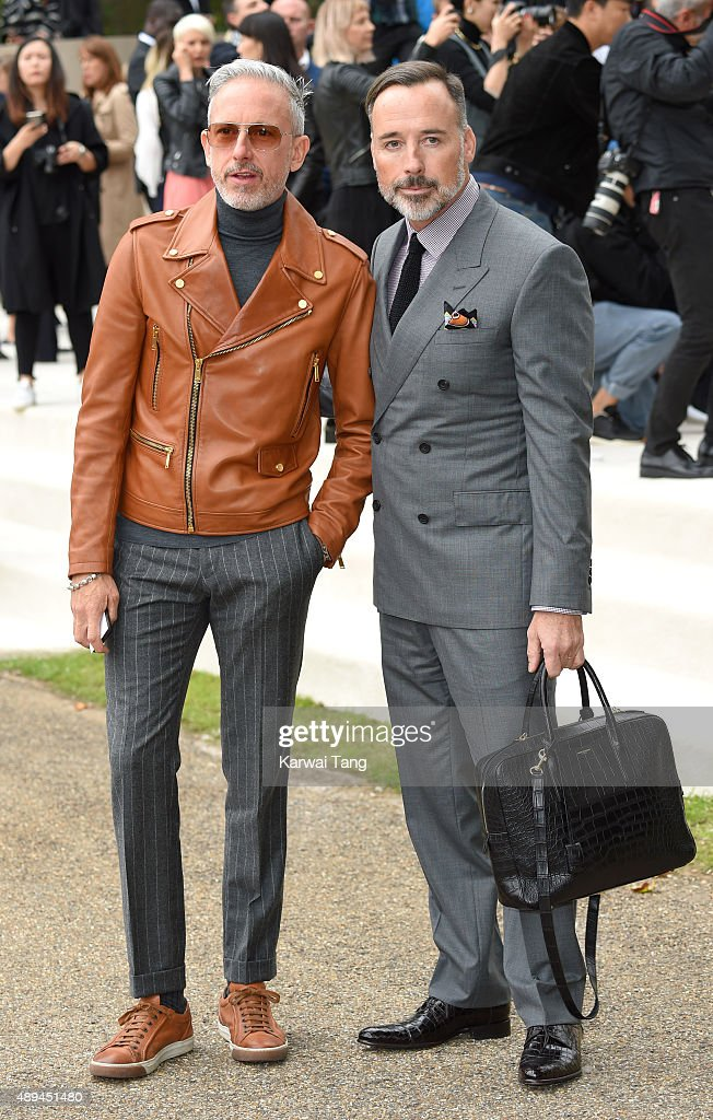 Patrick Cox and David Furnish attend the Burberry Prorsum show during London Fashion Week Spring/Summer 2016/17 at Kensington Gardens on September 21, 2015 in London, England.