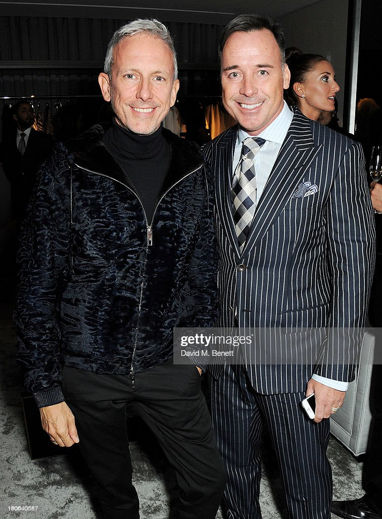 Patrick Cox (L) and David Furnish attend the launch of the new Tom Ford London flagship store on Sloane Street on September 15, 2013 in London, England.