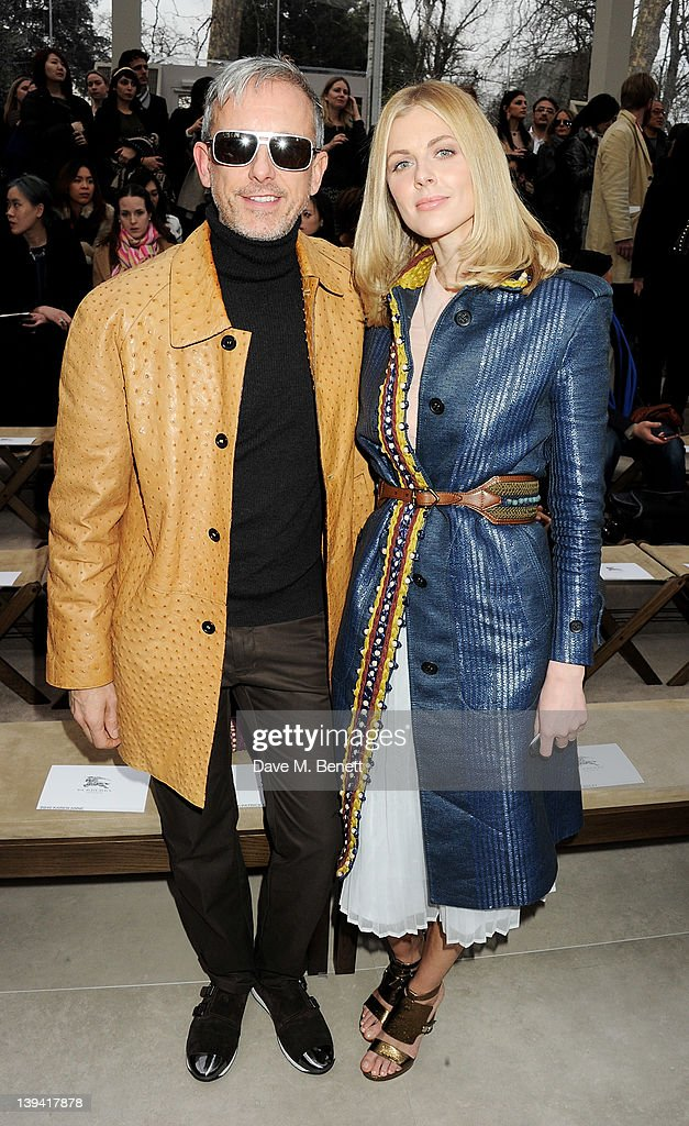 Patrick Cox (L) and Donna Air attend the Burberry Autumn Winter 2012 Womenswear Front Row during London Fashion Week at Kensington Gardens on February 20, 2012 in London, England.