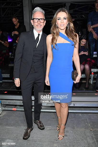 Patrick Cox and Elizabeth Hurley arrive at the Dsquared2 show during Milan Men's Fashion Week Fall/Winter 2017/18 on January 15 2017 in Milan Italy