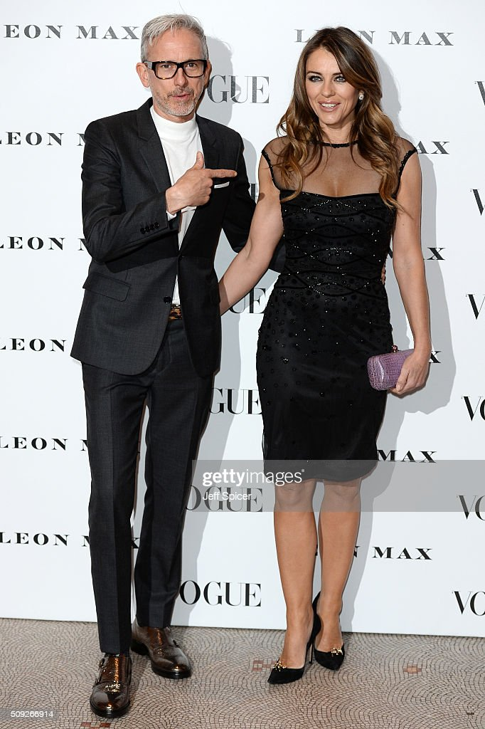 Patrick Cox and Elizabeth Hurley attend at Vogue 100 A Century of Style at the National Portrait Gallery on February 9 2016 in London England
