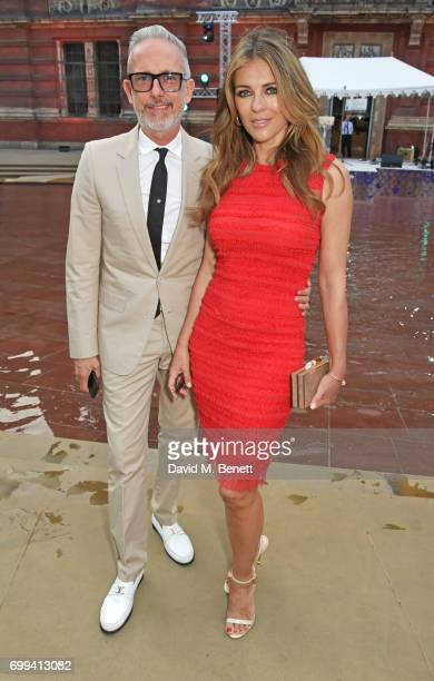 Patrick Cox and Elizabeth Hurley attend the 2017 annual VA Summer Party in partnership with Harrods at the Victoria and Albert Museum on June 21 2017...
