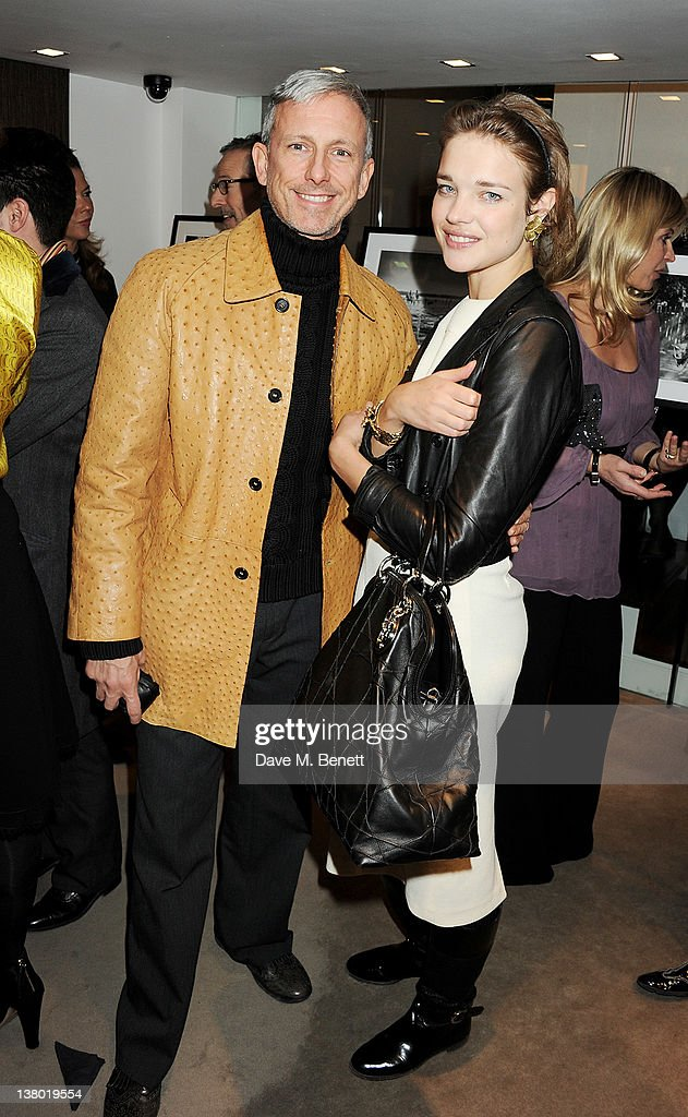 Patrick Cox (L) and Natalia Vodianova attend a private viewing of 'Gaucho', a photographic exhibition by Astrid Munoz, at the Jaeger-LeCoultre Boutique on January 31, 2012 in London, England.