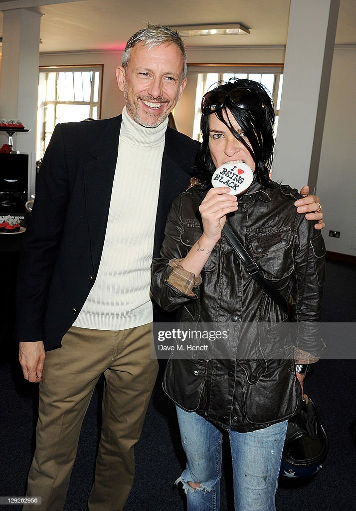 Patrick Cox (L) and Sue Webster attend the AMNESTEA Party hosted by Patrick Cox to celebrate Amnesty International's 50th Anniversary and launch 'Art Cakes & Cookies' at Royal Institute of British Architects on October 15, 2011 in London, England.