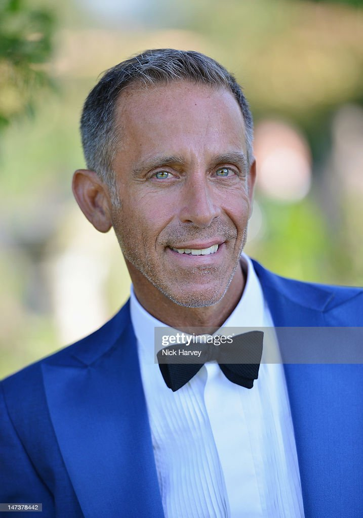 Patrick Cox poses at The 14th Annual White Tie and Tiara Ball to Benefit Elton John AIDS Foundation in Association with Chopard at Woodside on June 28, 2012 in Windsor, England. NO UK SALES BEFORE 17TH JULY 2012. NO HELLO, NOW, CLOSER, REVEAL, HEAT, LOOK OR GRAZIA SALES IN THE UK EVER. NO ITALY SALES BEFORE 4TH JULY 2012, NO SPAIN SALES BEFORE 7TH JULY 2012, NO MEXICO SALES BEFORE 1ST AUGUST 2012. All pictures are for editorial use only and mention of 'Chopard' and 'The Elton John Aids Foundation' are compulsory. No sales ever to any jewellers other than Chopard