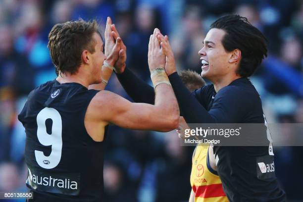 Patrick Cripps and Jack Silvagni of the Blues celebrate a goal during the round 15 AFL match between the Carlton Blues and the Adelaide Crows at...