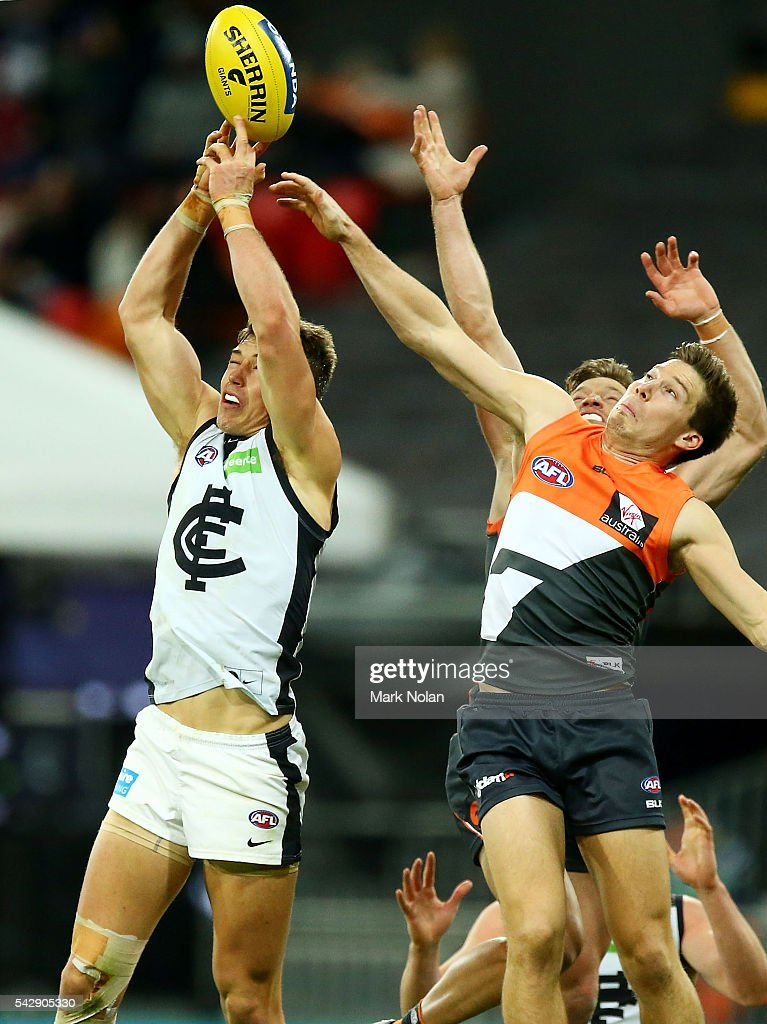 Patrick Cripps of Carlton and Heath Shaw of the Giants contest possession during the round 14 AFL match between the Greater Western Sydney Giants and the Carlton Blues at Spotless Stadium on June 25, 2016 in Sydney, Australia.