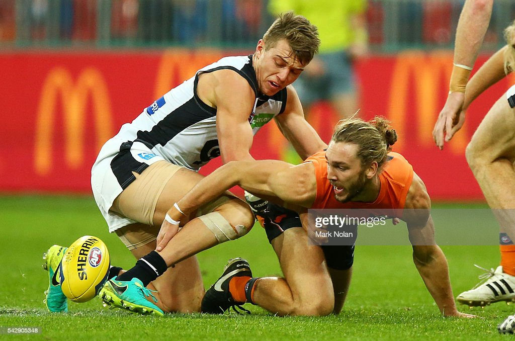 Patrick Cripps of Carlton and Matt Buntine of the Giants contest possession during the round 14 AFL match between the Greater Western Sydney Giants and the Carlton Blues at Spotless Stadium on June 25, 2016 in Sydney, Australia.