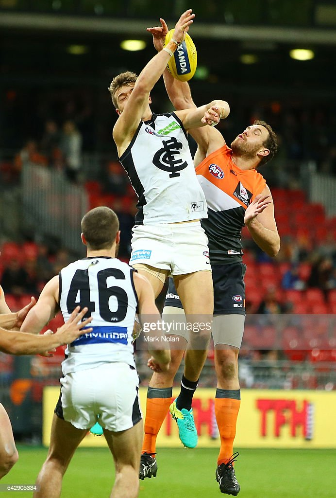 Patrick Cripps of Carlton and Shane Mumford of the Giants contest possession during the round 14 AFL match between the Greater Western Sydney Giants and the Carlton Blues at Spotless Stadium on June 25, 2016 in Sydney, Australia.