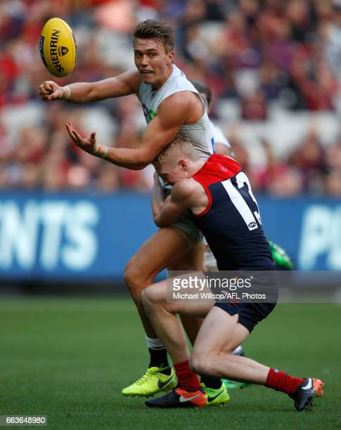 Patrick Cripps of the Blues is tackled by Clayton Oliver of the Demons during the 2017 AFL round 02 match between the Melbourne Demons and the...