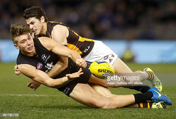 Patrick Cripps of the Blues is tackled by Isaac Smith Hawthorn during the 2015 AFL round 17 match between the Carlton Blues and the Hawthorn Hawks at...