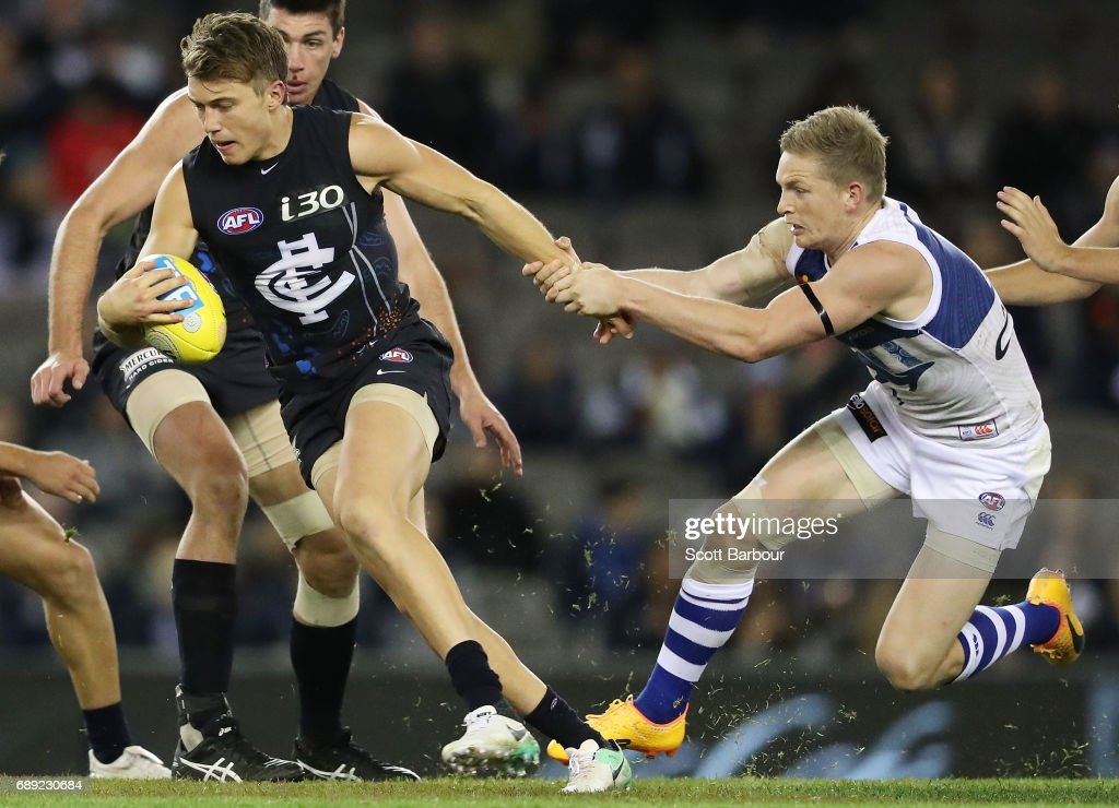 Patrick Cripps of the Blues is tackled by Jack Ziebell of the Kangaroos during the round 10 AFL match between the Carlton Blues and the North Melbourne Kangaroos at Etihad Stadium on May 28, 2017 in Melbourne, Australia.