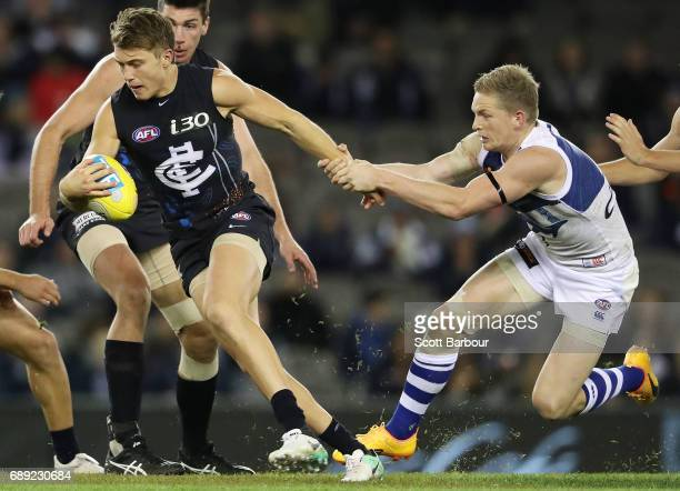 Patrick Cripps of the Blues is tackled by Jack Ziebell of the Kangaroos during the round 10 AFL match between the Carlton Blues and the North...