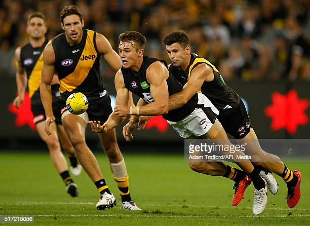 Patrick Cripps of the Blues is tackled by Trent Cotchin of the Tigers during the 2016 AFL Round 01 match between the Richmond Tigers and the Carlton...