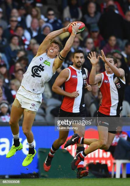 Patrick Cripps of the Blues marks infront of Jack Steele of the Saints during the round eight AFL match between the St Kilda Saints and the Carlton...