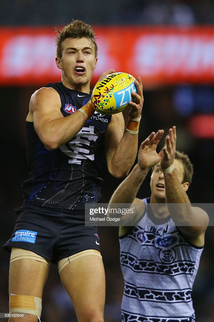 Patrick Cripps of the Blues marks the ball against Lachie Henderson of the Cats during the round 10 AFL match between the Carlton Blues and the Geelong Cats at Etihad Stadium on May 29, 2016 in Melbourne, Australia.