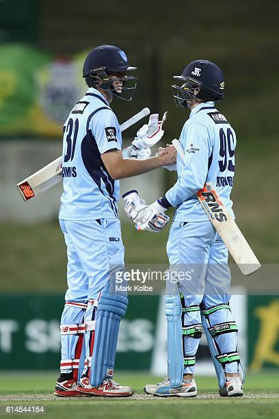 Patrick Cummins and Ben Rohrer of the Blues celebrate victory during the Matador BBQs One Day Cup match between Queensland and New South Wales at...