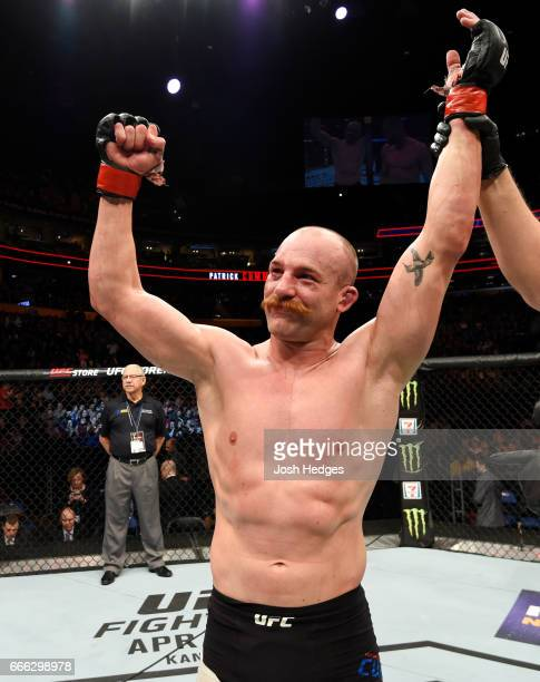 Patrick Cummins celebrates his majority decision victory over Jan Blachowicz of Poland in their light heavyweight bout during the UFC 210 event at...