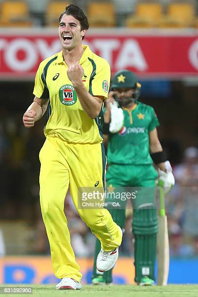 Patrick Cummins of Australia celebrates dismssing Babar Azam of Pakistan during game one of the One Day International series between Australia and...