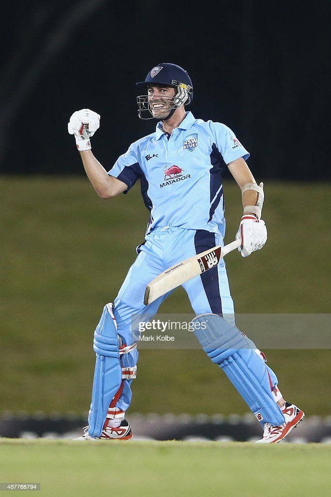 Patrick Cummins of the Blues celebrates hitting the winning runs for victory during the Matador BBQs One Day Cup Elimination Final match between Queensland and New South Wales at Blacktown International Sportspark on October 24, 2014 in Sydney, Australia.