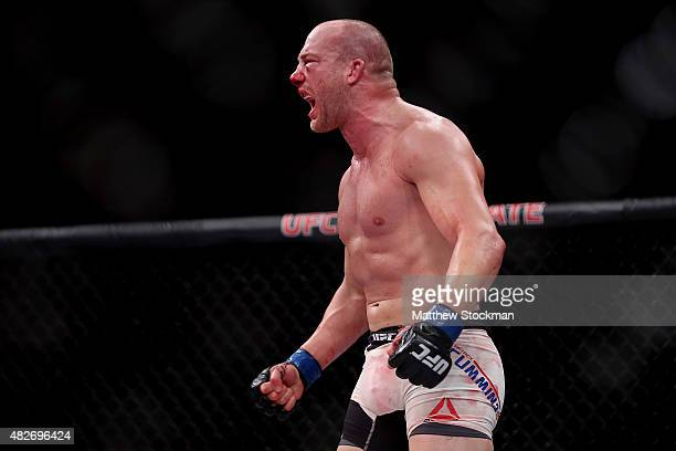 Patrick Cummins of the United States celebrates his TKO of Rafael Cavalcante of Brazil States in their light heavyweight bout during the UFC 190...