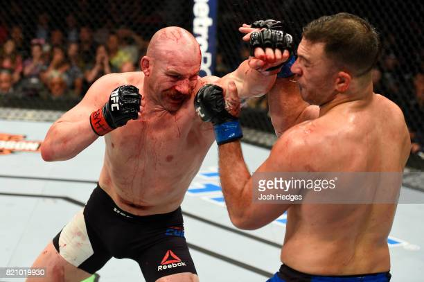 Patrick Cummins punches Gian Villante in their light heavyweight bout during the UFC Fight Night event inside the Nassau Veterans Memorial Coliseum...