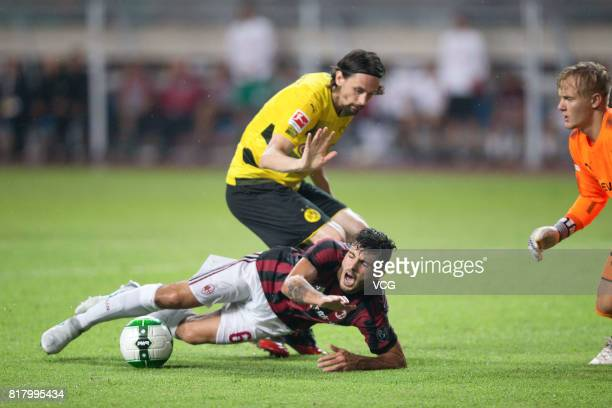 Patrick Cutrone of AC Milan and Neven Subotic of Borussia Dortmund compete for the ball during the 2017 International Champions Cup China between AC...