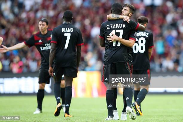 Patrick Cutrone of AC Milan celebrates a goal with teammate Cristian Zapata during the 2017 International Champions Cup China match between FC Bayern...