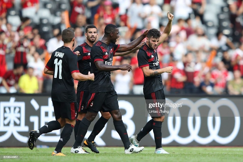 Kits by BK-201 ::NO REQUESTS:: - Page 2 Patrick-cutrone-of-ac-milan-celebrates-a-goal-with-teammate-during-picture-id820644962