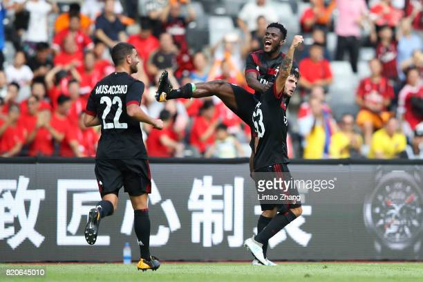 Patrick Cutrone of AC Milan celebrates a goal with teammate during the 2017 International Champions Cup China match between FC Bayern and AC Milan at...