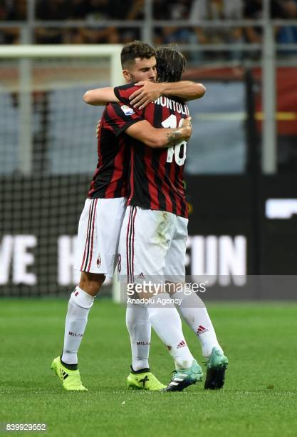 Patrick Cutrone of AC Milan celebrates with his teammate Riccardo Montolivo after scoring a goal during Serie A soccer match between AC Milan and...