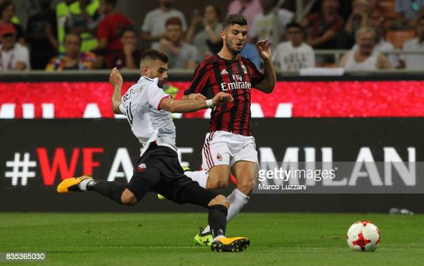 Patrick Cutrone of AC Milan is challenged by Egzon Bejtulai of KF Shkendija 79 during the UEFA Europa League Qualifying PlayOffs round first leg...
