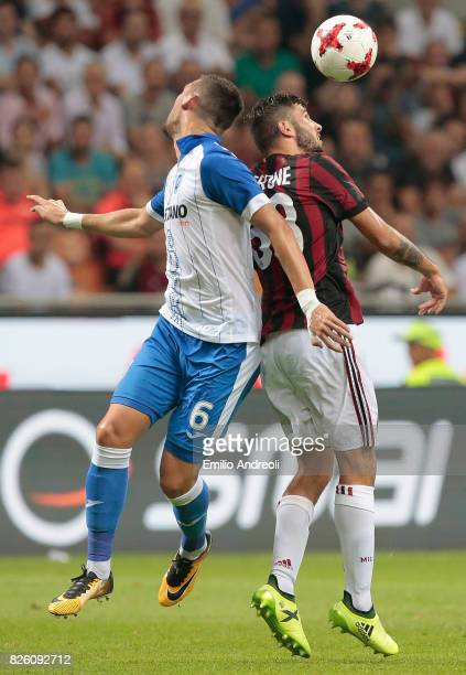 Patrick Cutrone of AC Milan jumps for the ball with Renato Kelic of CS U Craiova during the UEFA Europa League Third Qualifying Round Second Leg...