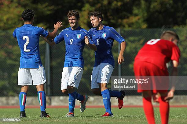 Patrick Cutrone of Italy celebrates his goal with his teammates Dario Antonino Scuderi and Riccardo Marchizza during the international friendly match...