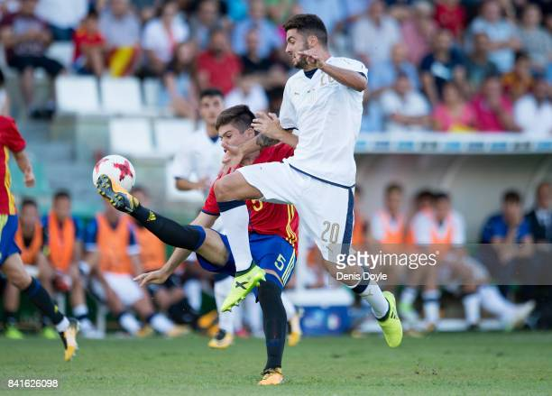 Patrick Cutrone of Italy is challenged by Jorge Mere of Spain during the Italy v Spain Under21 Friendly match at Estadio Municipal Salta del Caballo...
