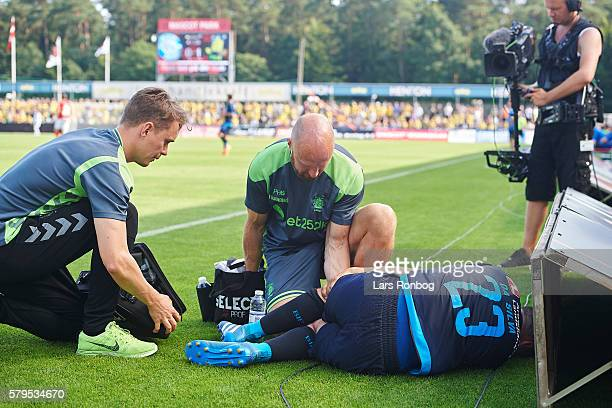 Patrick da Silva of Brondby IF lies injured on the pitch during the Danish Alka Superliga match between Silkeborg IF and Brondby IF at Mascot Park on...