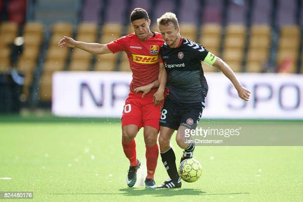 Patrick da Silva of FC Nordsjalland and Rasmus Würtz of AaB Aalborg compete for the ball during the Danish Alka Superliga match between FC...