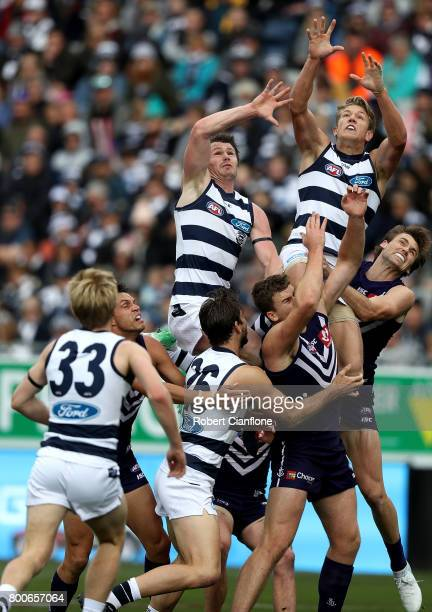 Patrick Dangerfield and Rhys Stanley of the Cats leap for the ball during the round 14 AFL match between the Geelong Cats and the Fremantle Dockers...