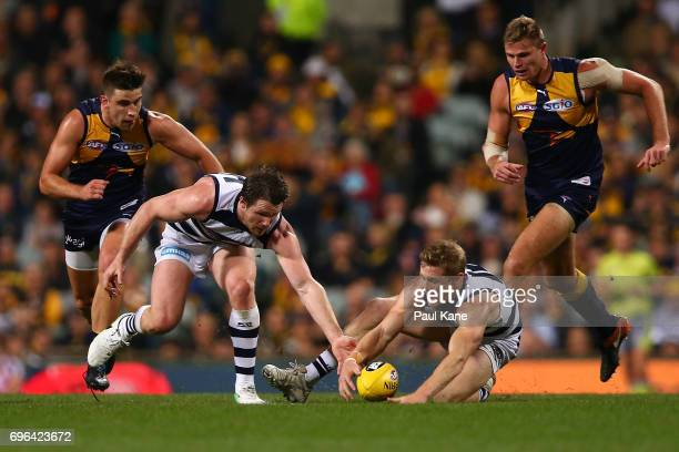 Patrick Dangerfield and Scott Selwood of the Cats contest for the ball during the round 13 AFL match between the West Coast Eagles and the Geelong...