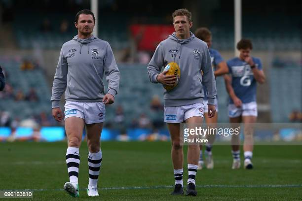 Patrick Dangerfield and Scott Selwood of the Cats walk from the field following the first warm up session during the round 13 AFL match between the...