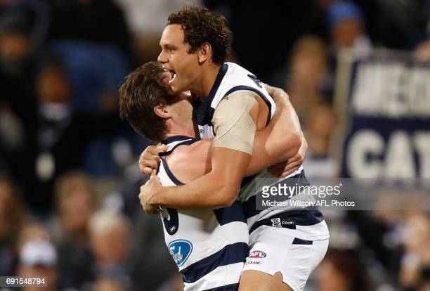 Patrick Dangerfield and Steven Motlop of the Cats celebrate during the 2017 AFL round 11 match between the Geelong Cats and the Adelaide Crows at...