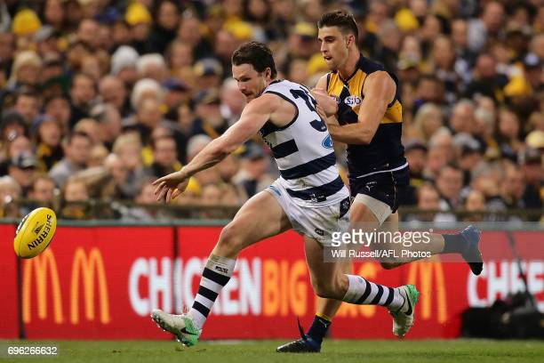 Patrick Dangerfield of the Cats and Elliot Yeo of the Eagles chase the ball during the round 13 AFL match between the West Coast Eagles and the...