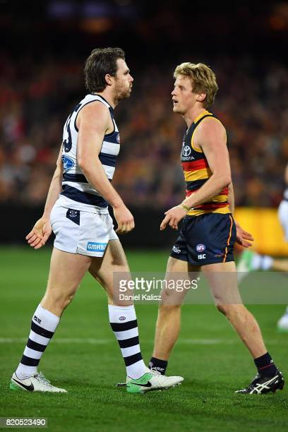 Patrick Dangerfield of the Cats and Rory Sloane of the Crows look on during the round 18 AFL match between the Adelaide Crows and the Geelong Cats at...