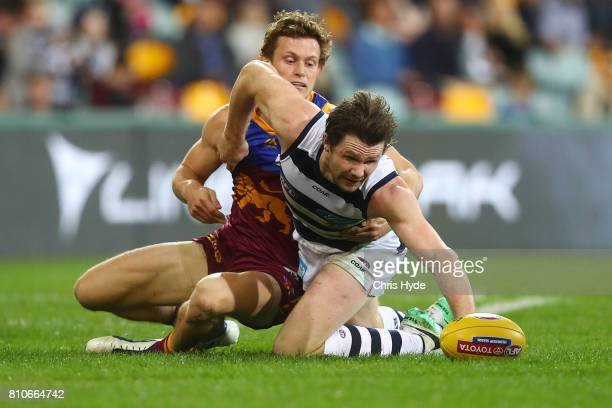 Patrick Dangerfield of the Cats and Ryan Lester of the Lions compete for the ball during the round 16 AFL match between the Brisbane Lions and the...