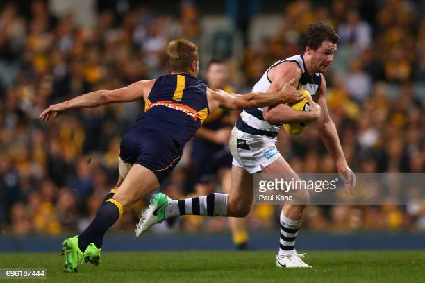 Patrick Dangerfield of the Cats attempts to break from a tackle by Sam Mitchell of the Eagles during the round 13 AFL match between the West Coast...