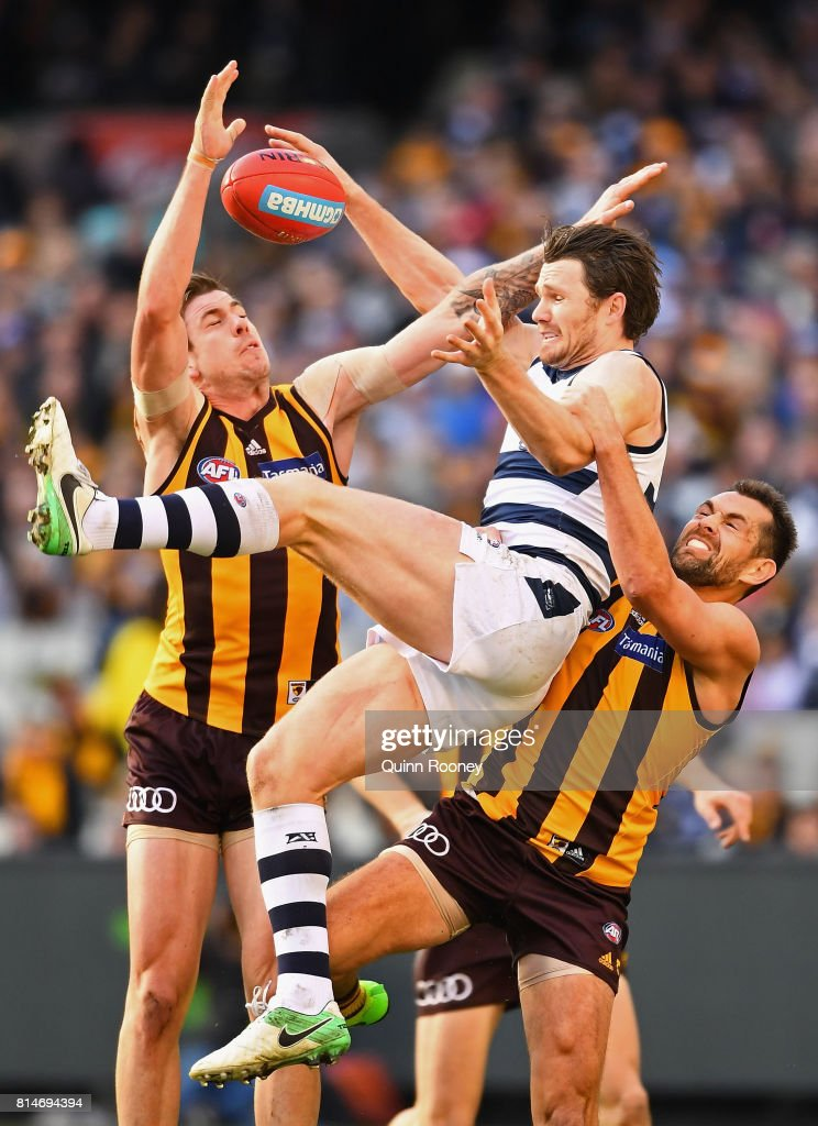Patrick Dangerfield of the Cats attempts to mark over the top of Luke Hodge of the Hawks during the round 17 AFL match between the Geelong Cats and the Hawthorn Hawks at Melbourne Cricket Ground on July 15, 2017 in Melbourne, Australia.